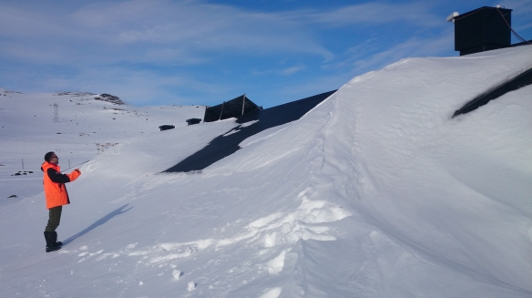 It's somewhere in there!  Benny identifies Finse Station under drifted snow.