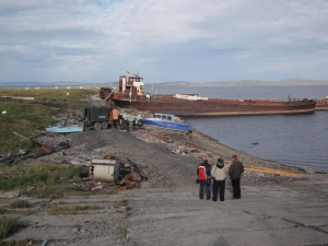 Our lovely blue boat being pushed into the water in Tiksi